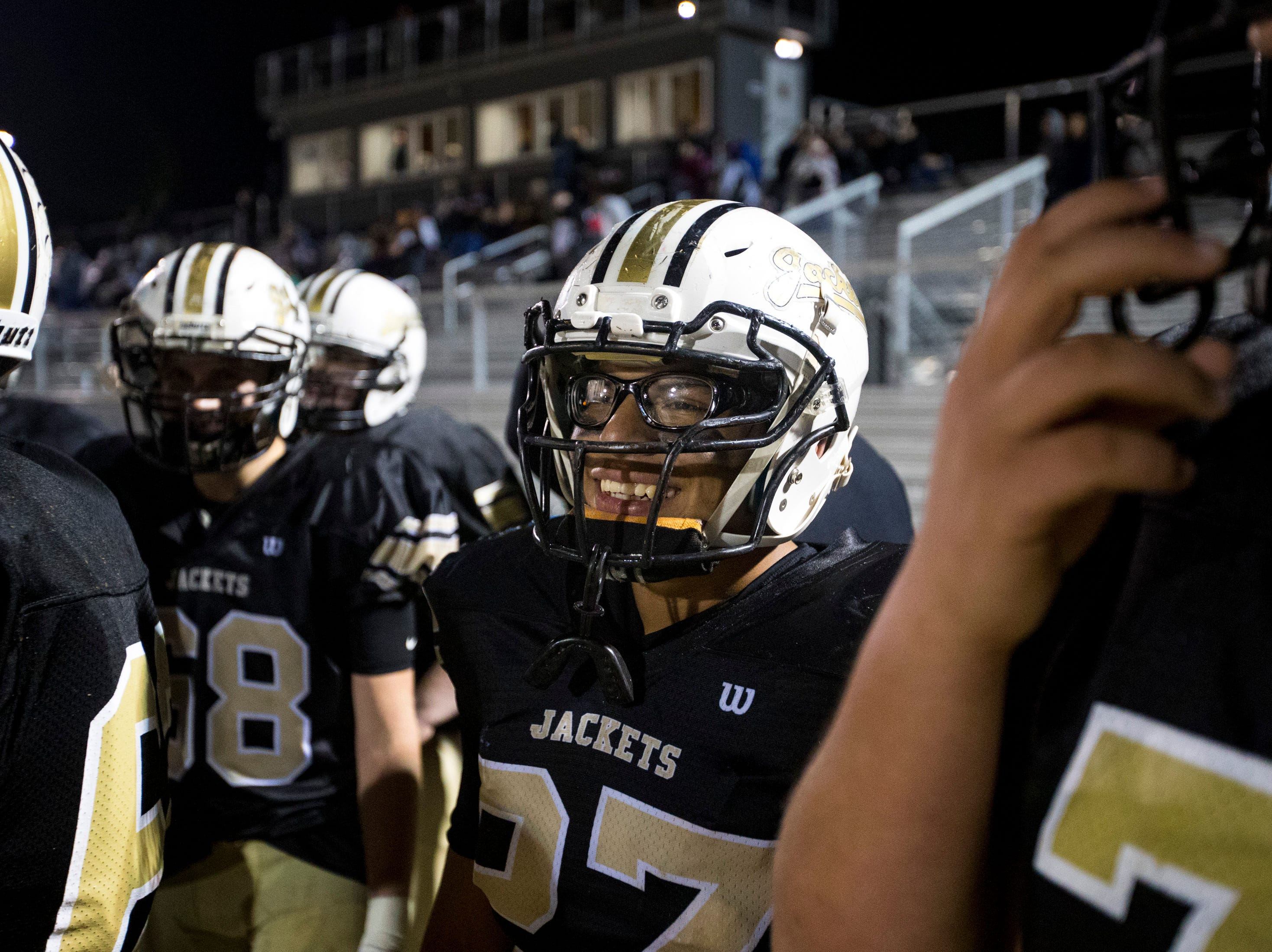Springfield's Yonel Rodriguez (27) smiles on the sideline during Springfield's game against Chester County at Springfield High School in Springfield on Friday, Nov. 2, 2018.