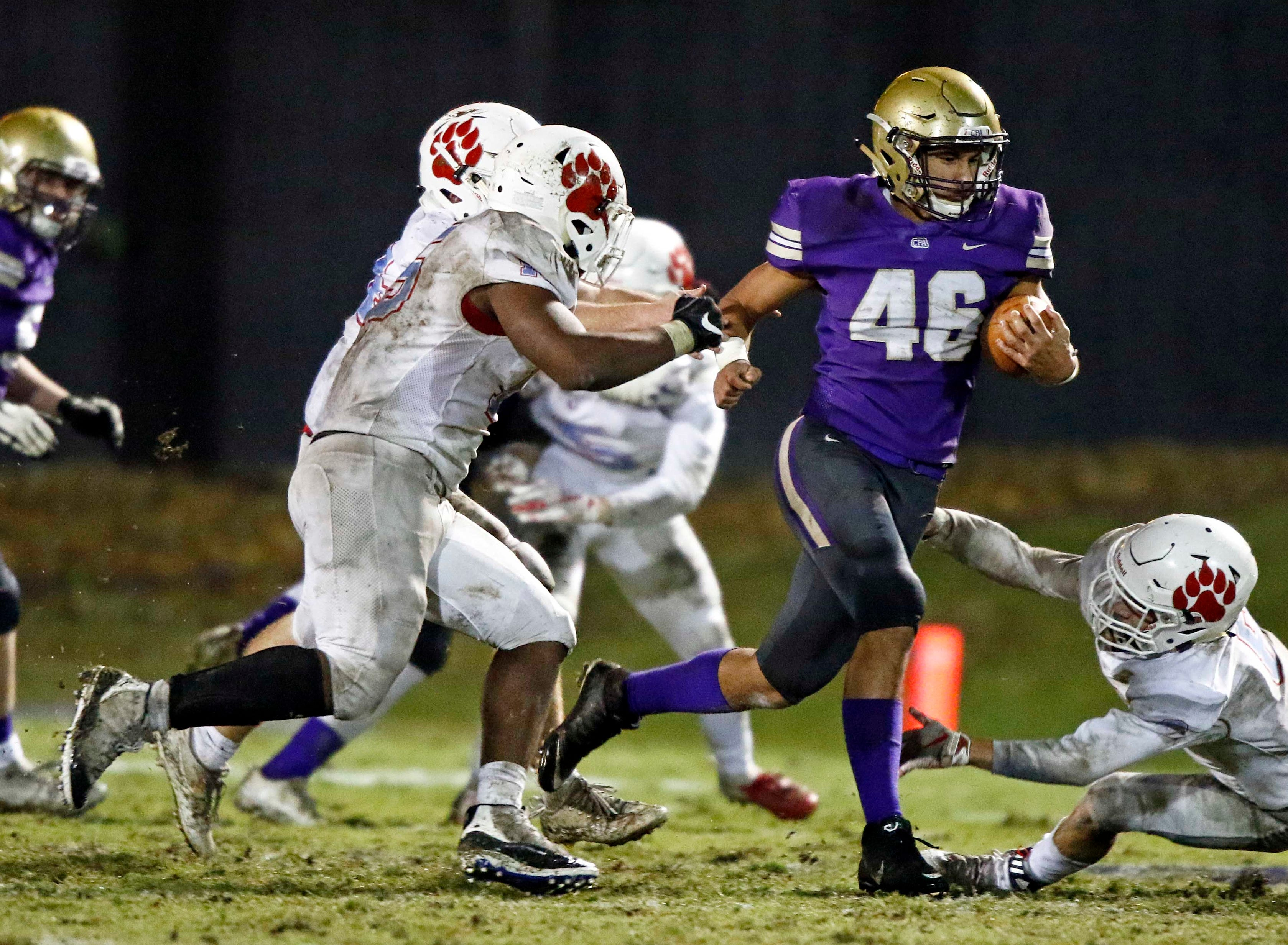 CPA's Ethan Stewart (46) runs for yardages as he's chased by the USJ defense during their game Friday, Nov. 2, 2018, in Nashville, TN.