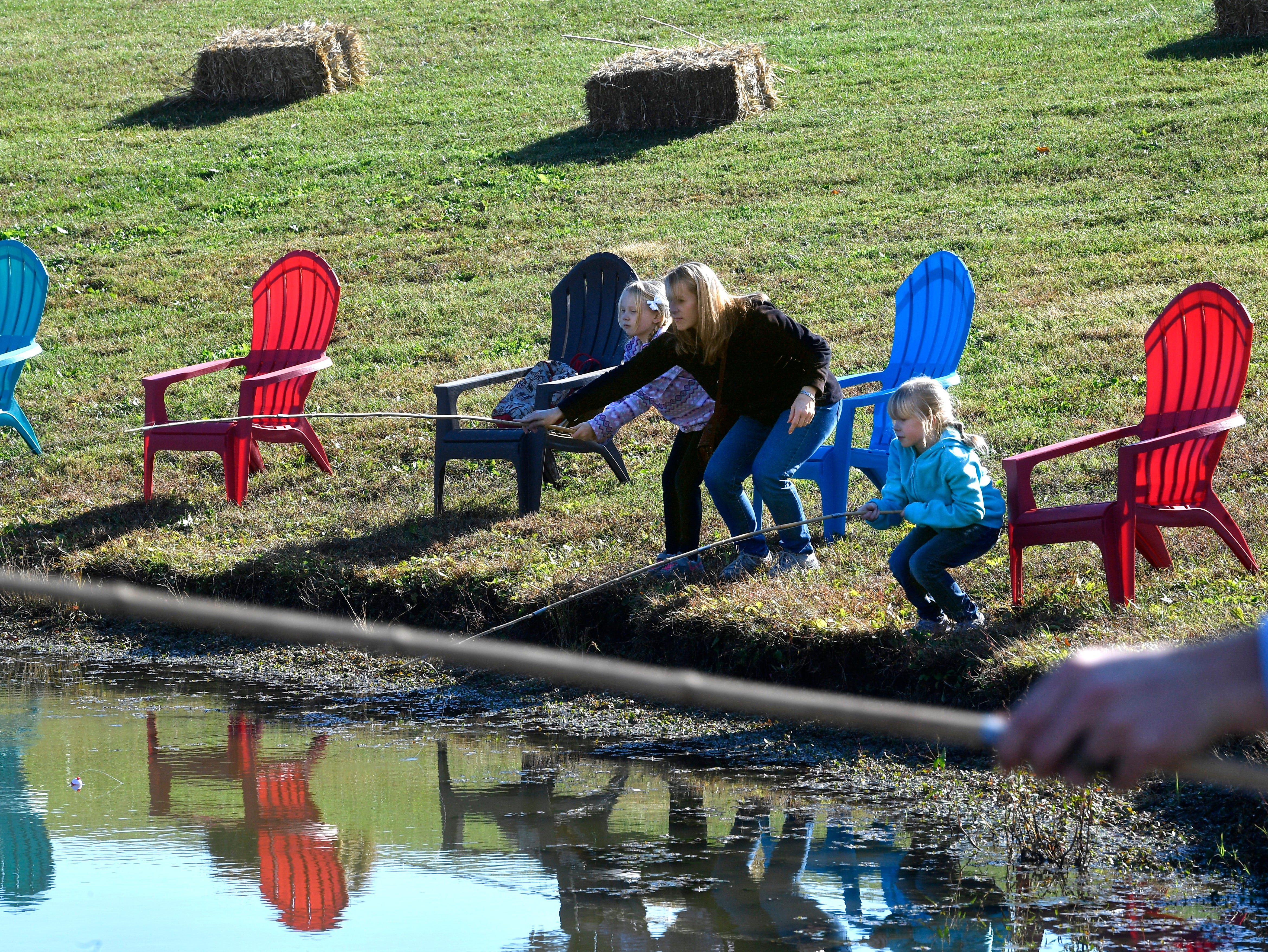 Family Day at the Park at Harlinsdale Farms gave families time to try their hand at fishing with cane poles in the pond Saturday Nov. 3, 2018, in Franklin, Tenn.