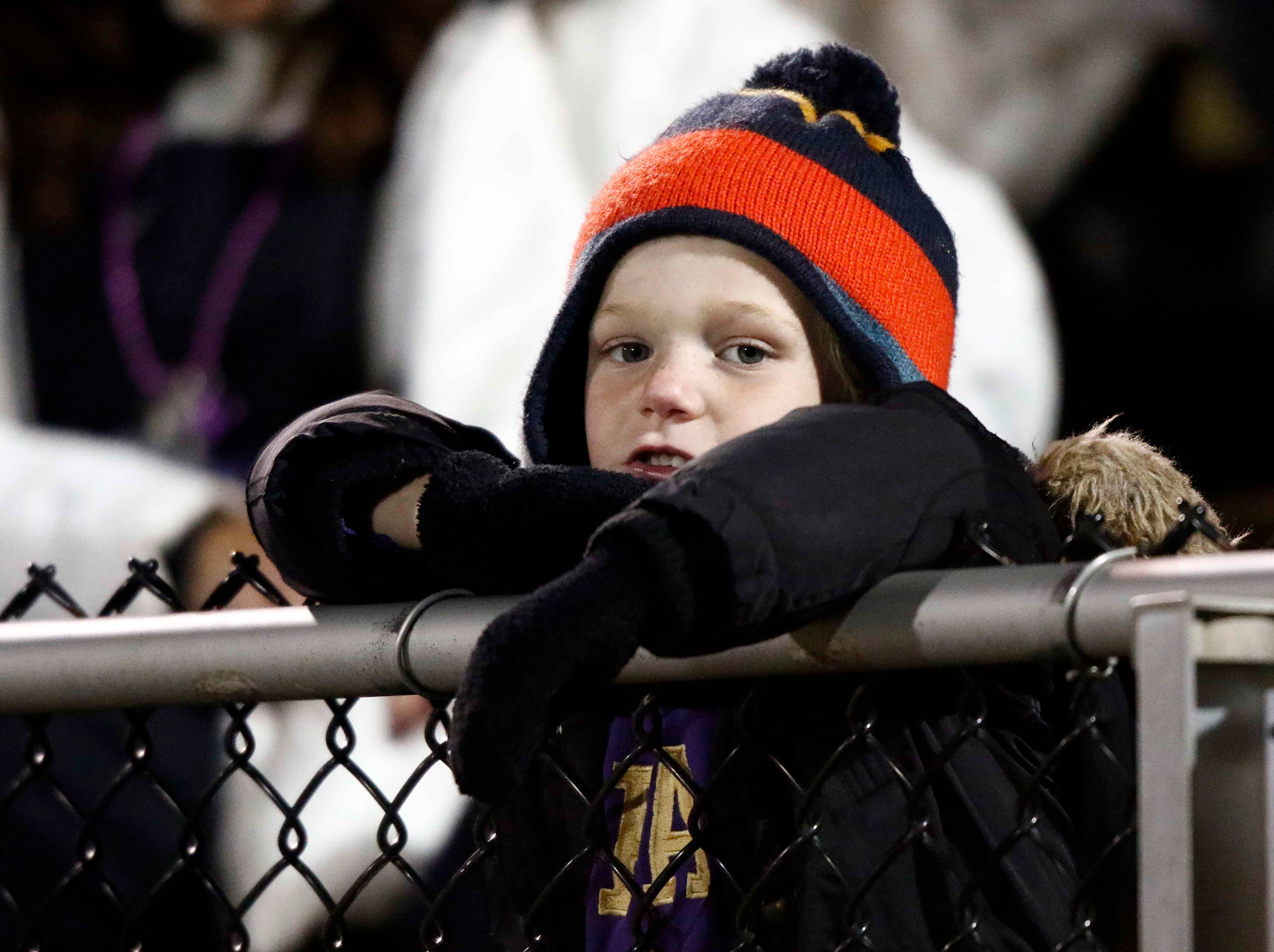 A young CPA fan leans on the fence during their game against USJ Friday, Nov. 2, 2018, in Nashville, Tenn.