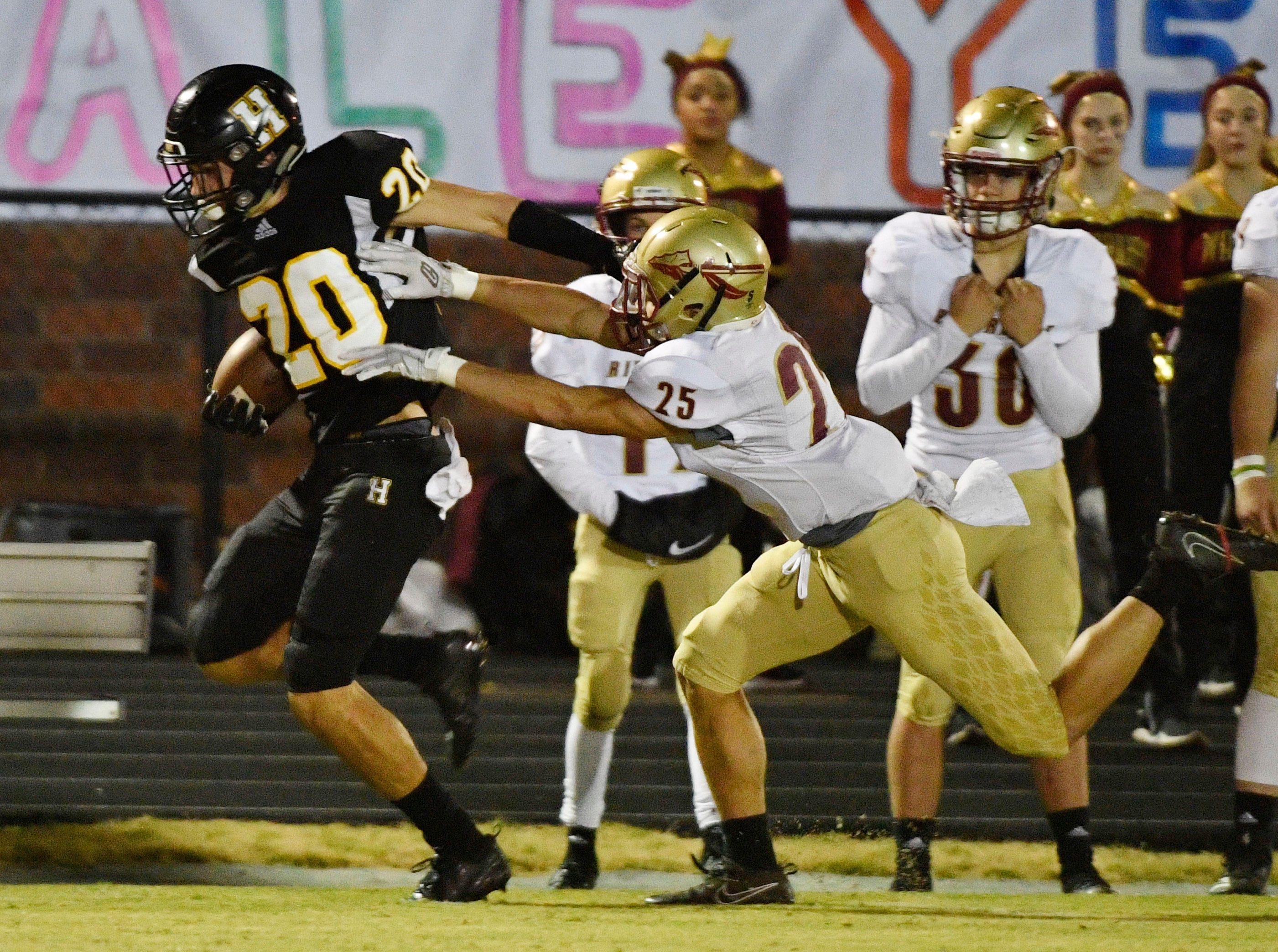 Hendersonville's Nate Hancock is pushed out of bounds by Rifverdale's CJ Johnson as Riverdale plays at Hendersonville Friday Nov. 2, 2018, in Hendersonville, Tenn.
