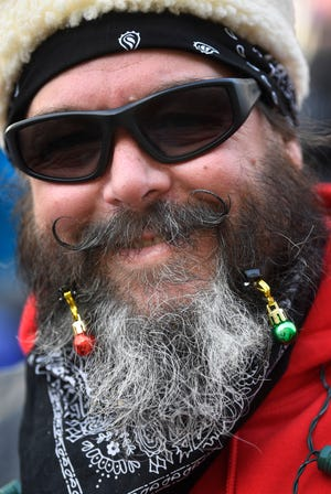 """""""Bacardi"""" Bob is decked out in festive style for the parade.For the 24th year, Boswell's Harley-Davidson is partnering with the MNPD for Saturday's Annual Toy Parade, a significant fundraising event for the police department's Christmas Basket Program benefiting needy Nashville families Saturday Nov. 3, 2018, in Nashville, Tenn."""