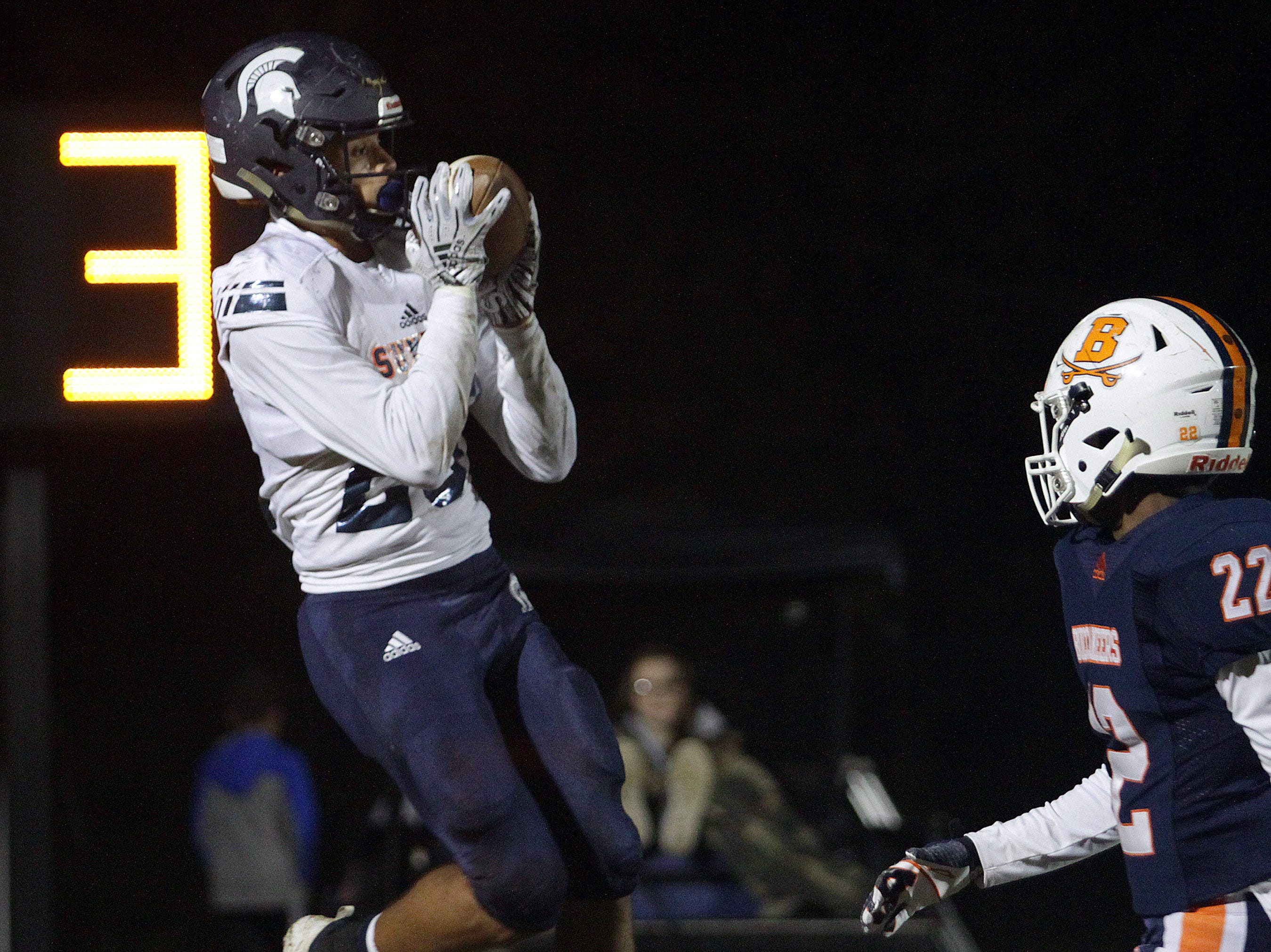 Summit's George Odimegwu catches a TD pass over Beech's Caleb Clayton on Friday, November 2, 2018.