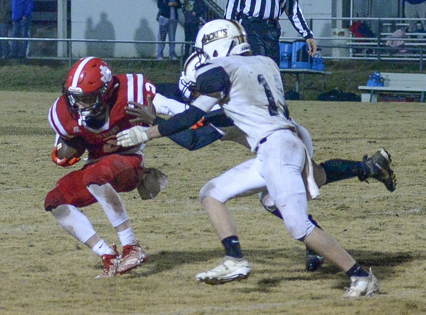 Jo Byrns High School player Blake Jernigan tries to avoid the defense of Lookout Valley at Jo Byrns High School on Friday, Nov. 2.
