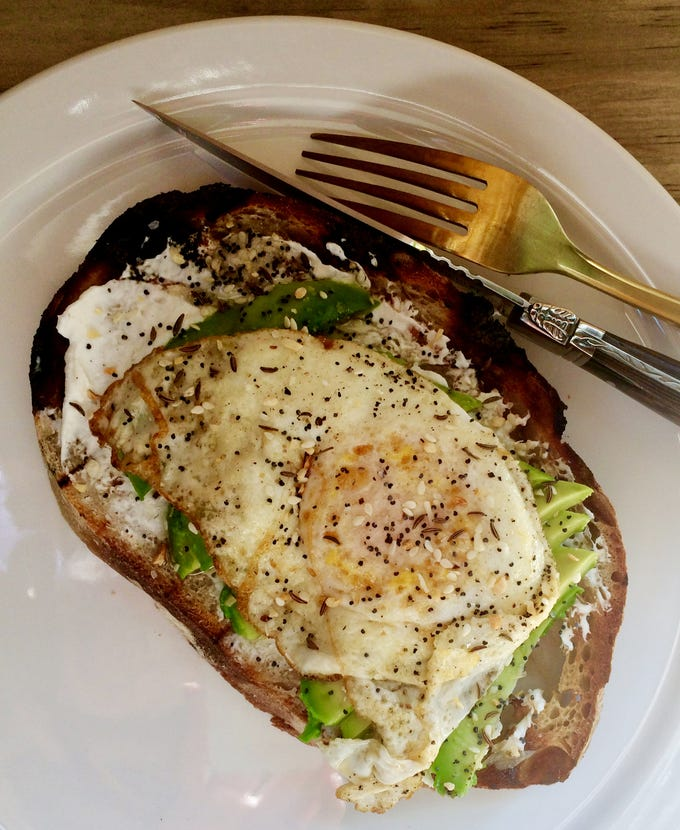 """Avocado toast on sourdough with """"Everything"""" spice blend and over-easy egg at Slow Hand Coffee + Bakeshop in East Nashville."""