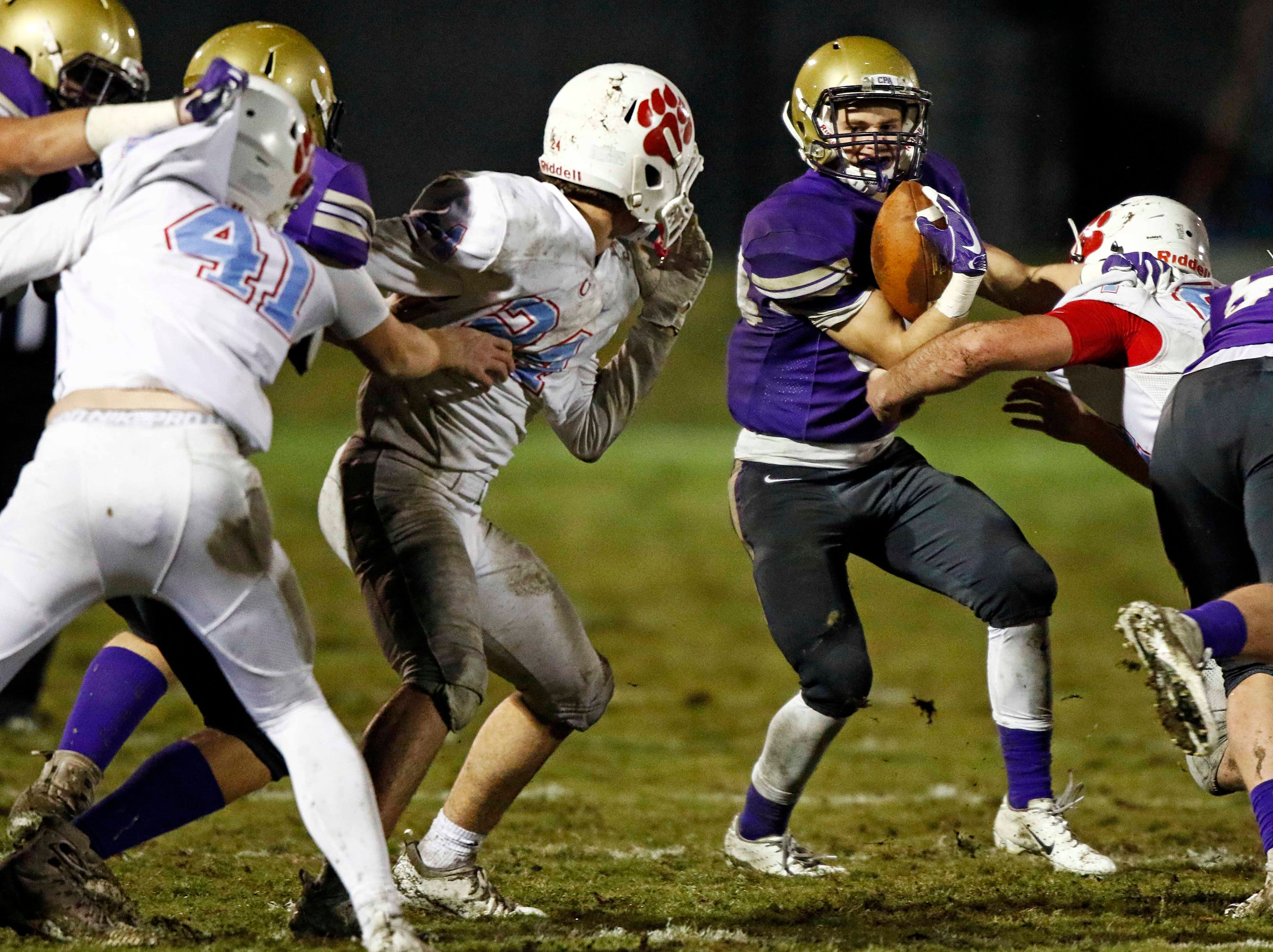 CPA's Andrew Whitely runs for yardage as he tries to avoid being tackled by the USJ defense during their game Friday, Nov. 2, 2018, in Nashville, TN.