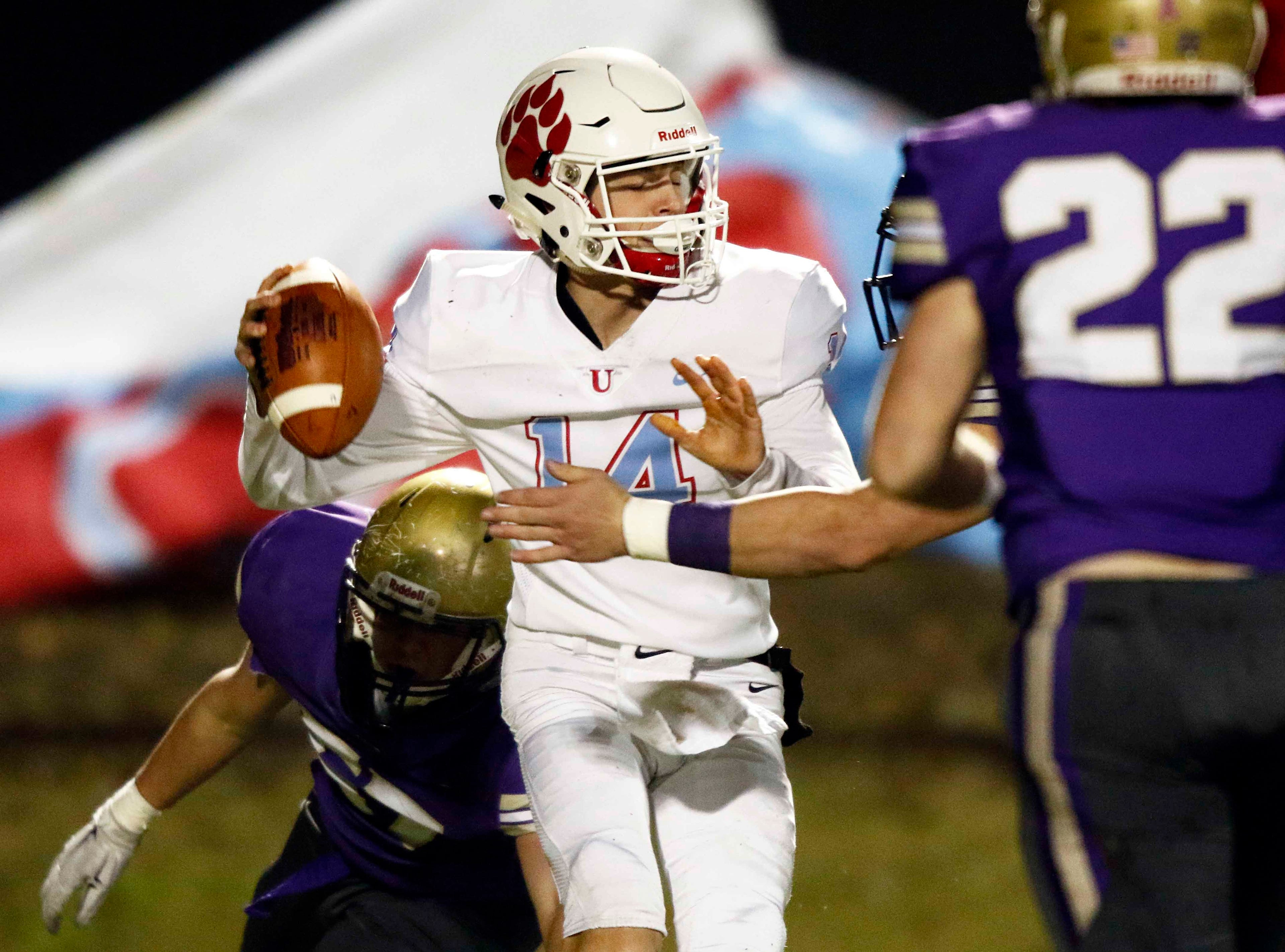 USJ quarterback Andrew Smith tries to avoid being sacked during their game against CPA Friday, Nov. 2, 2018, in Nashville, Tenn.