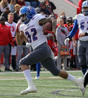 Tennessee State running back Earl Harrison, who rushed for more than 100 yards for the first time this season, runs the ball against Southeast Missouri in Saturday's game.