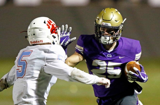 CPA's Noah Henderson (25) runs for yardage as he tries to avoid USJ's Brendon Long (5) during their game Friday, Nov. 2, 2018, in Nashville, Tenn.