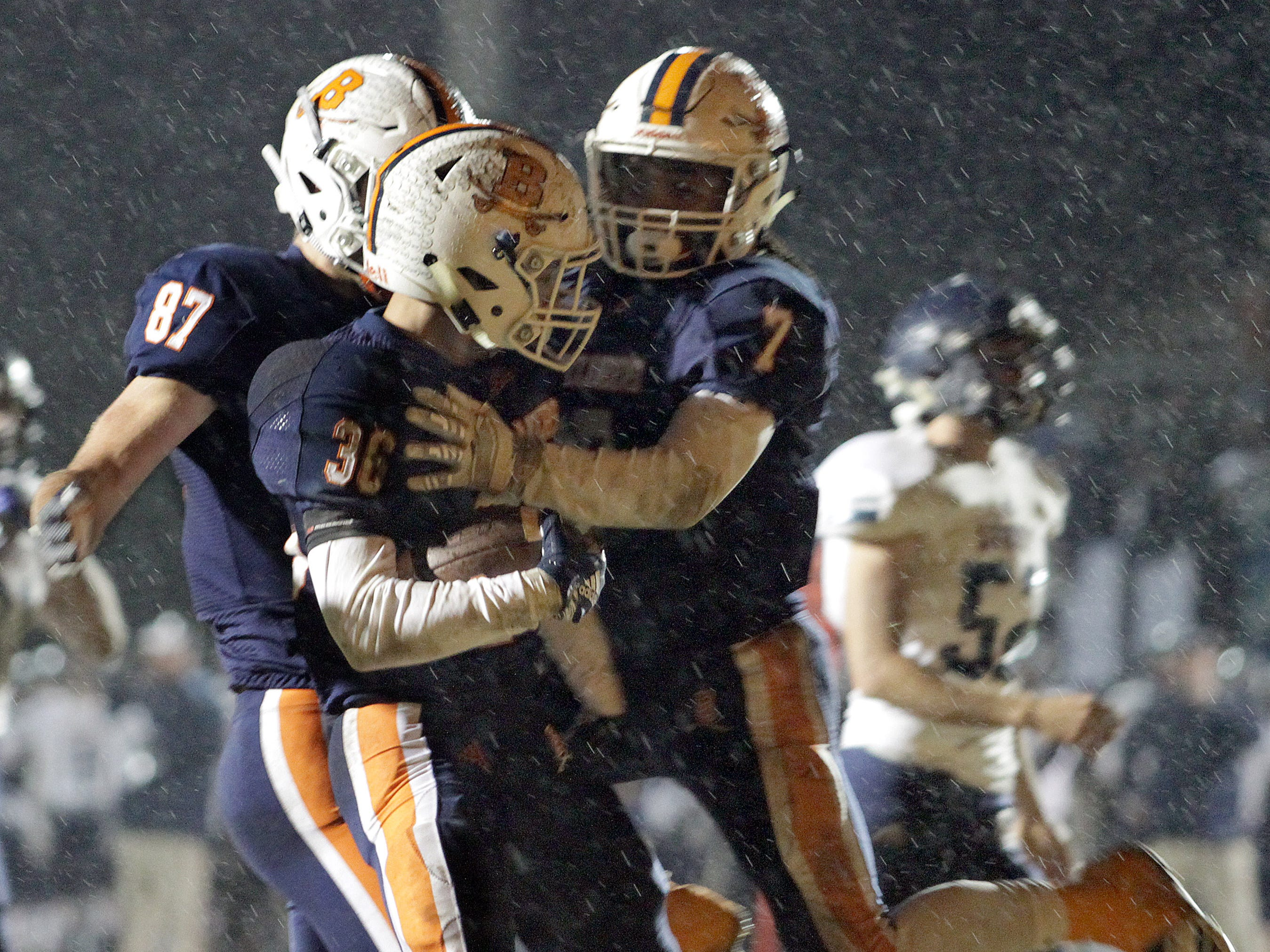 Beech's Aaron foxx is greeted after scoring a TD against Beech by Davis Ward and Ja' Sean Parks on Friday, November 2, 2018.