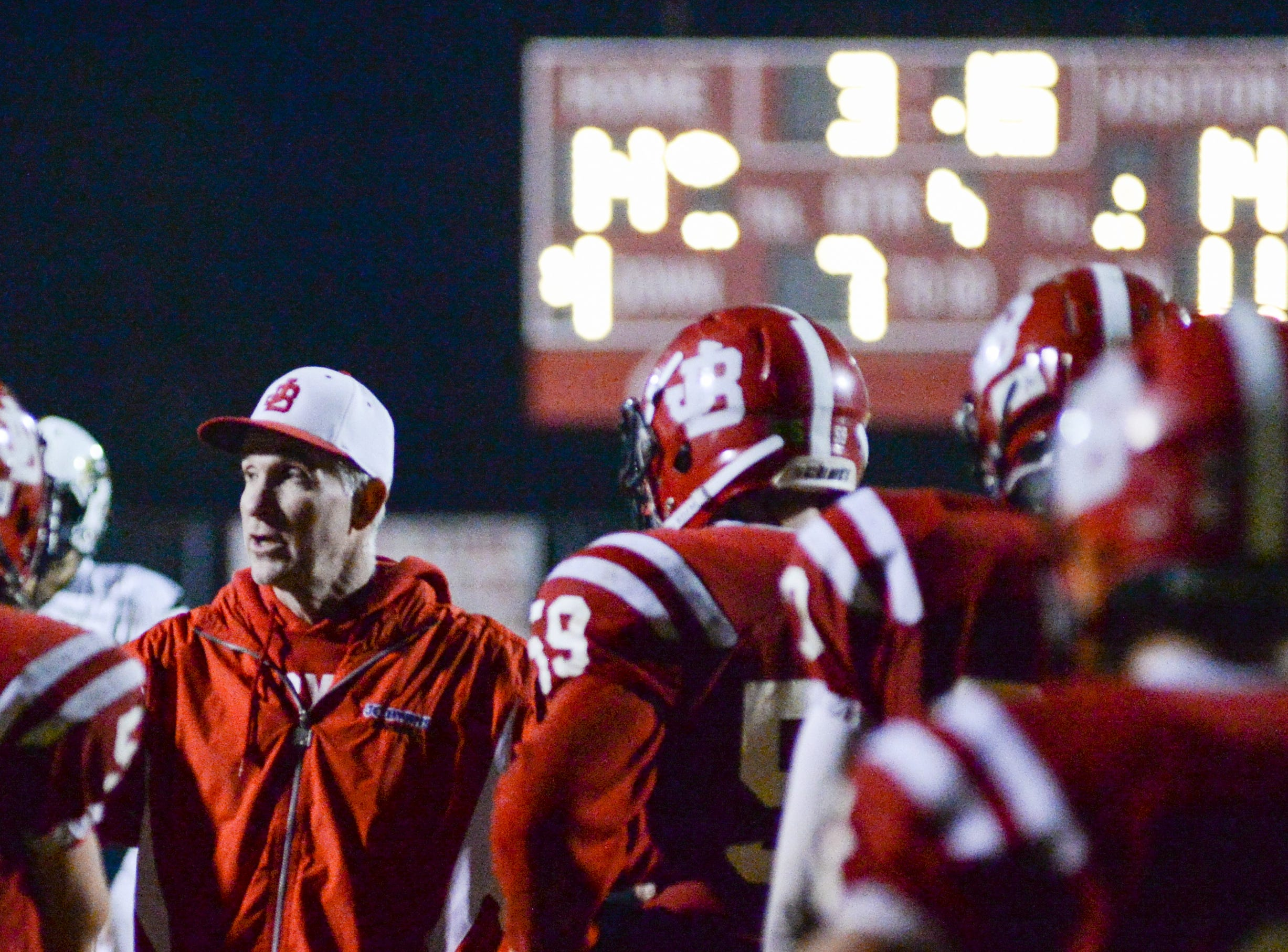 Jo Byrns High School coach Tom Adkins talks with players during a pause in the action due to an injury during a game against Lookout Valley at Jo Byrns High School on Friday, Nov. 2.