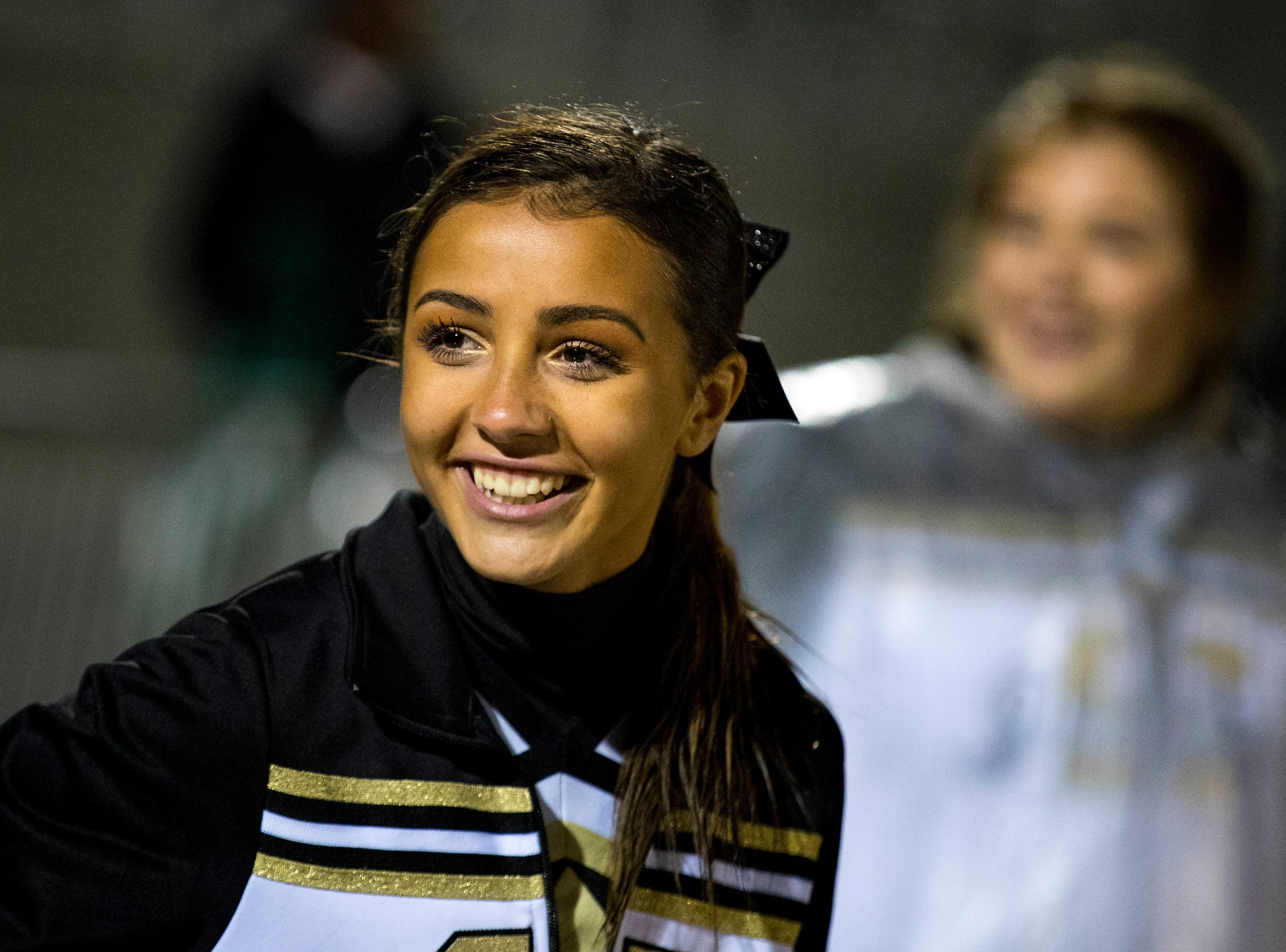 Springfield's cheerleader Gabby Rivera smiles during Springfield's game against Chester County at Springfield High School in Springfield on Friday, Nov. 2, 2018.