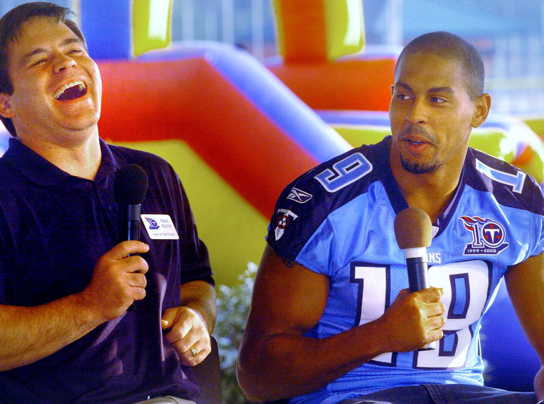 The voice of the Tennessee Titans, Mike Keith, left, and Titans wide receiver, Justin McCareins, right, laugh during a television interview at the Tennessee Titans Caravan at the West Tennessee Healthcare Sportsplex in Jackson in 2008.