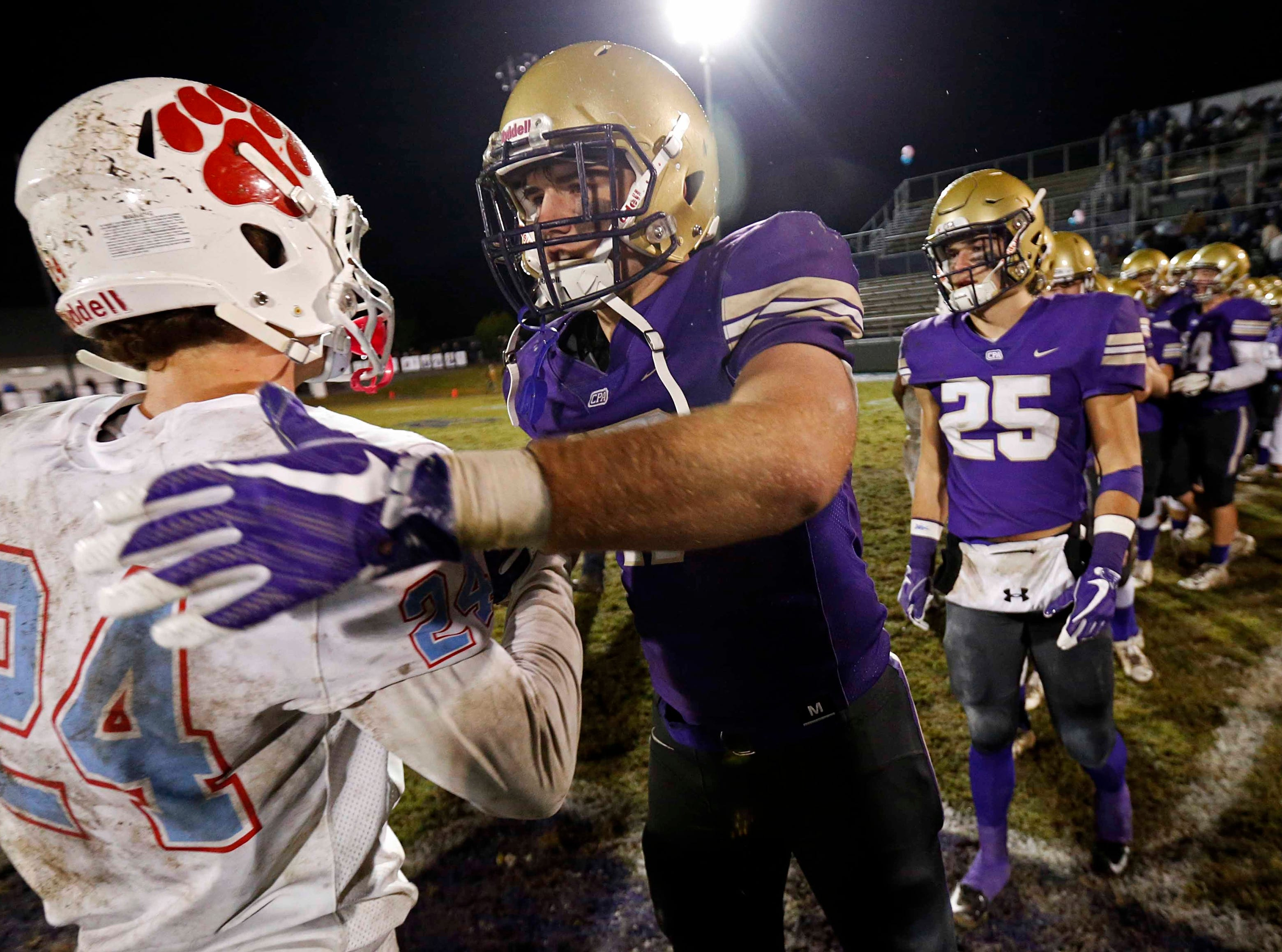 CPA's Bryce McCormick shakes hands with USJ's Craig Carter (24) after their game Friday, Nov. 2, 2018, in Nashville, TN.