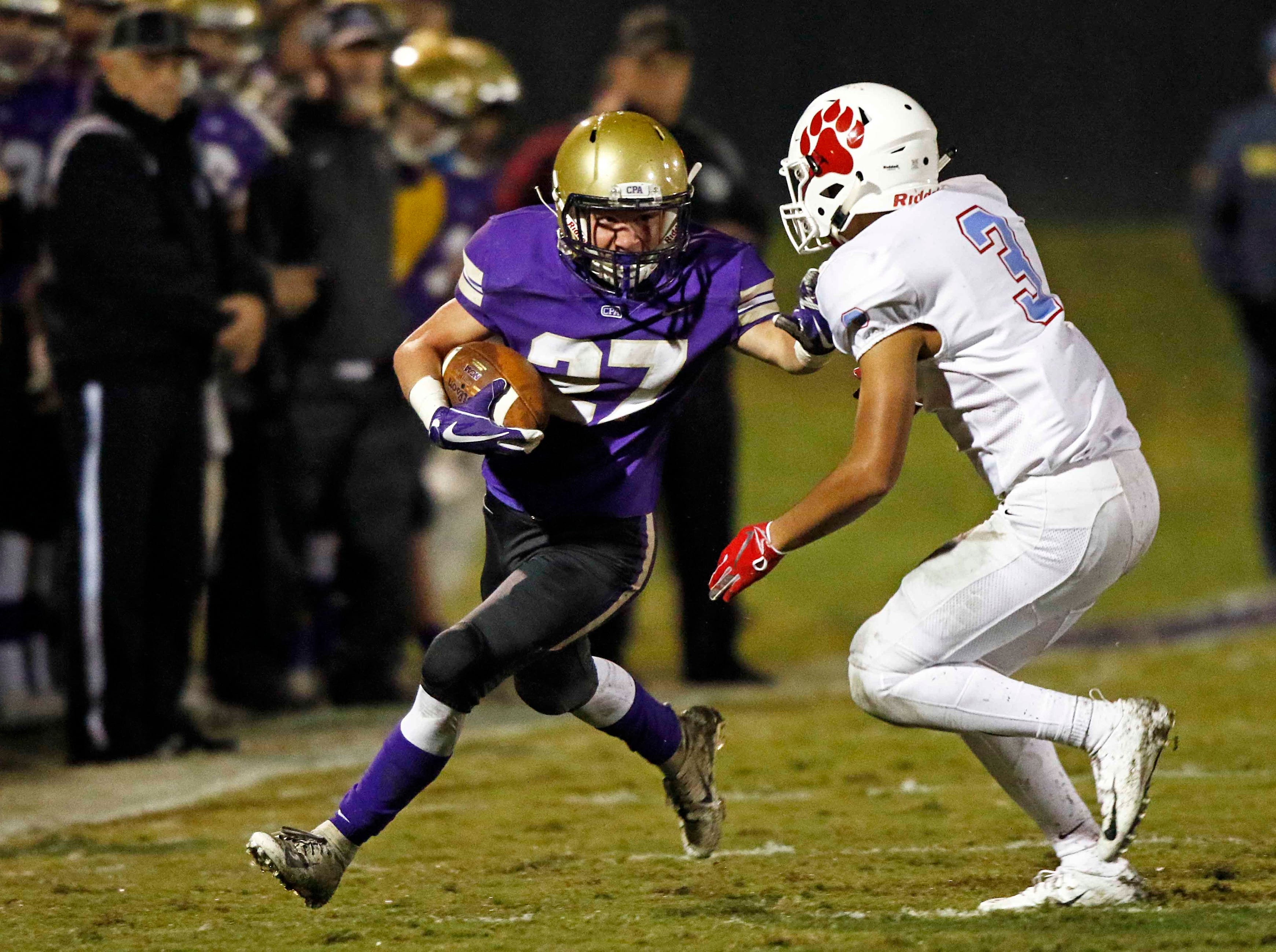 CPA's Keegan Moore (27) runs for yardage as he tries to avoid being tackled by USJ's Christian Wallace (3) during their game Friday, Nov. 2, 2018, in Nashville, TN.