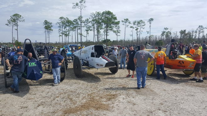 Drivers and swamp buggies wait their turn for a practice lap at Florida Sports Park on Saturday, Nov. 3, 2018. It was test and tune day at the track in advance on Sunday's Swamp Buggy Races 2018 Fall Classic.