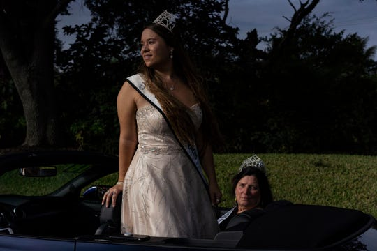 Swamp Buggy Queens Erica Flesher, 23, left, and Vicki Batcher, 67, pose for a photo while waiting  for the 70th annual Swamp Buggy Parade to start Saturday morning, Nov. 3, 2018. Flesher is the currently reigning queen, serving the past four years. The first Swamp Buggy Queen was crowned in 1950. Saturday's parade featured a handful of past Swamp Buggy Queens, Naples High School marching band, racing buggies and Swampy - the race mascot, among other things.