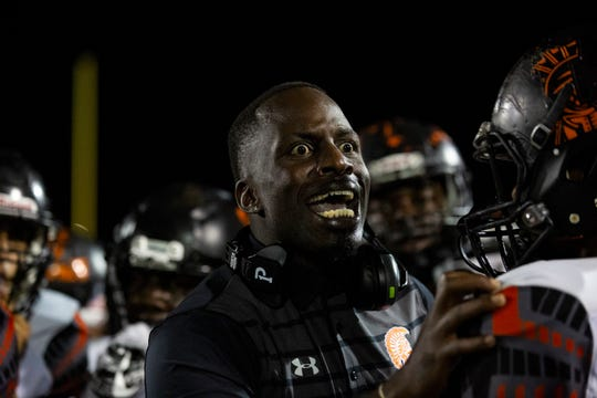 Coach, Fritz Jacques of Lely High School shares strategies with his team on Friday, November 2, 2018, at Palmetto Ridge High School in Naples.