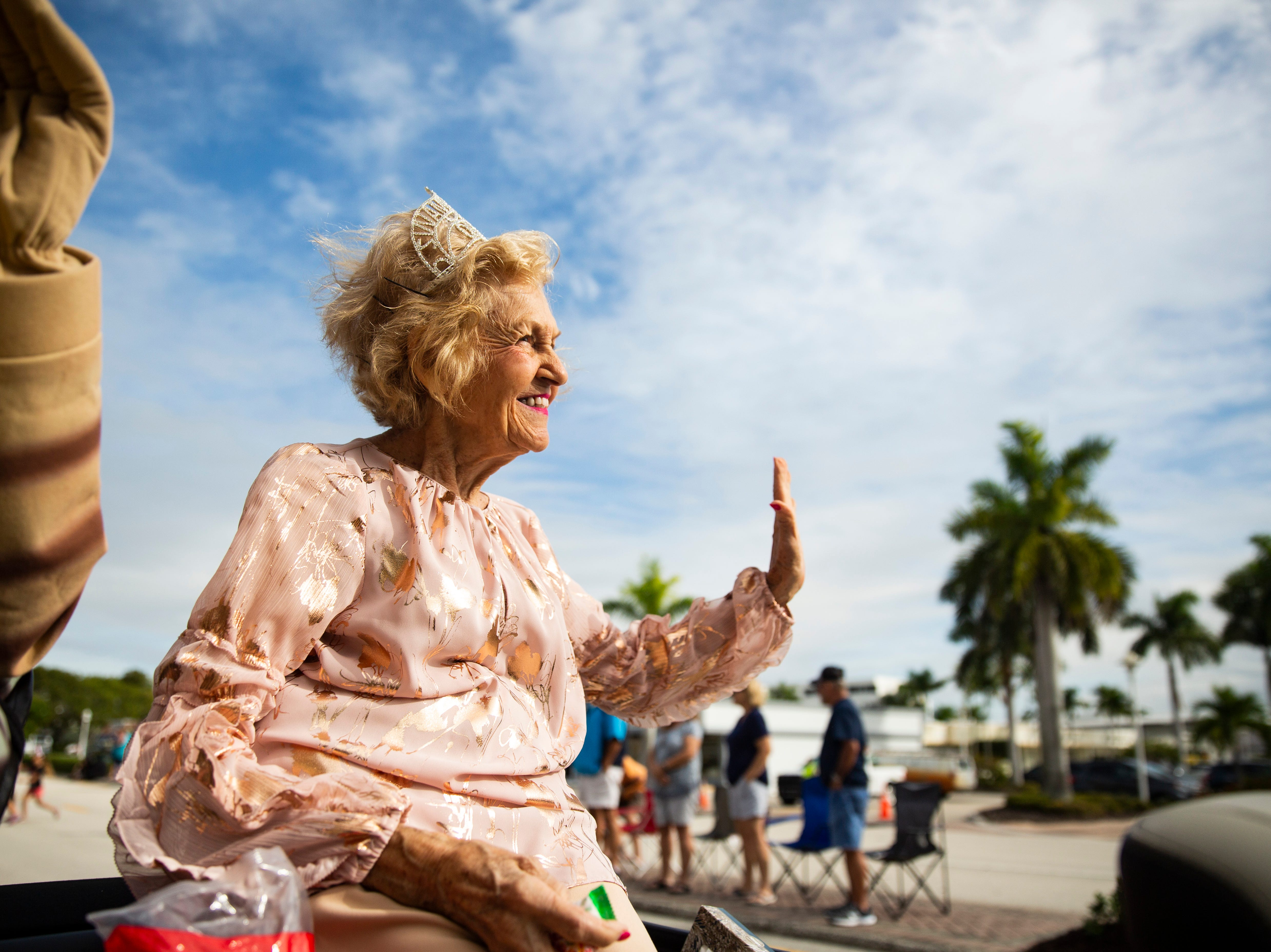 Dolly Scott, 83, waves to spectators during the 70th annual Swamp Buggy Parade Saturday morning, Nov. 3, 2018. She was crowned Swamp Buggy Queen in 1966. She's one of nearly 70 queens part of swamp buggy history. Saturday's parade featured past Swamp Buggy Queens, Naples High School marching band, racing buggies and Swampy - the race mascot, among other things.