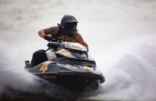 Erminio Iantosca of Naples wins the first Pro-Am Runabout GP race on Saturday at the Pro Watercross World Championship after months of workout and anticipation.