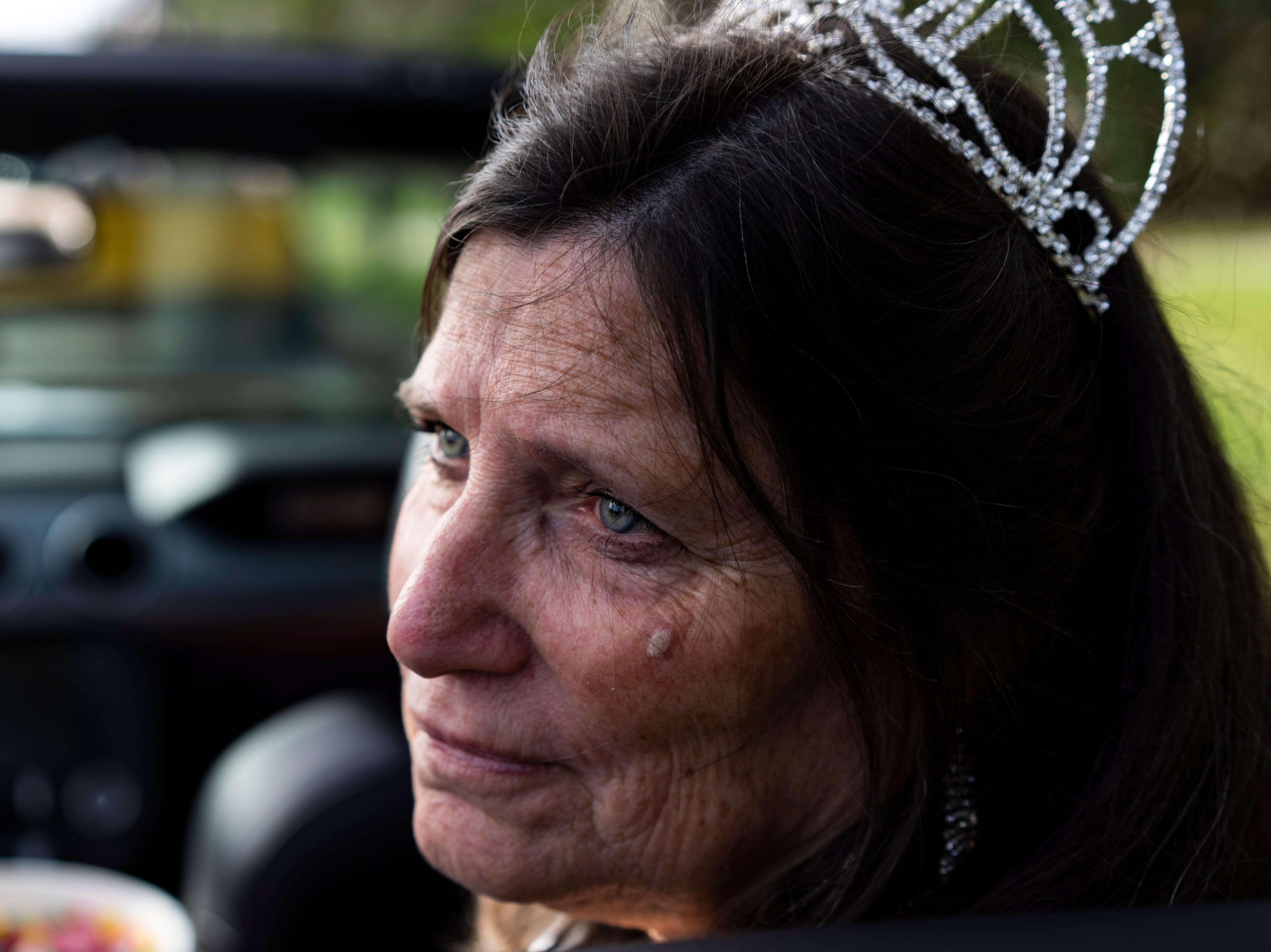 Vicki Batcher, 67, waits in a convertible for the 70th annual Swamp Buggy Parade to start Saturday morning, Nov. 3, 2018. She was crowned Swamp Buggy Queen in 1969. She's one of nearly 70 queens part of swamp buggy history. Saturday's parade featured past Swamp Buggy Queens, Naples High School marching band, racing buggies and Swampy - the race mascot, among other things.