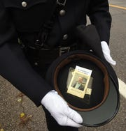 Newark Poilice officer Chelsea Rubio cares a remembrance from former Kirkersville Police Chief Steven Eric DiSario funeral in her dress uniform's hat.