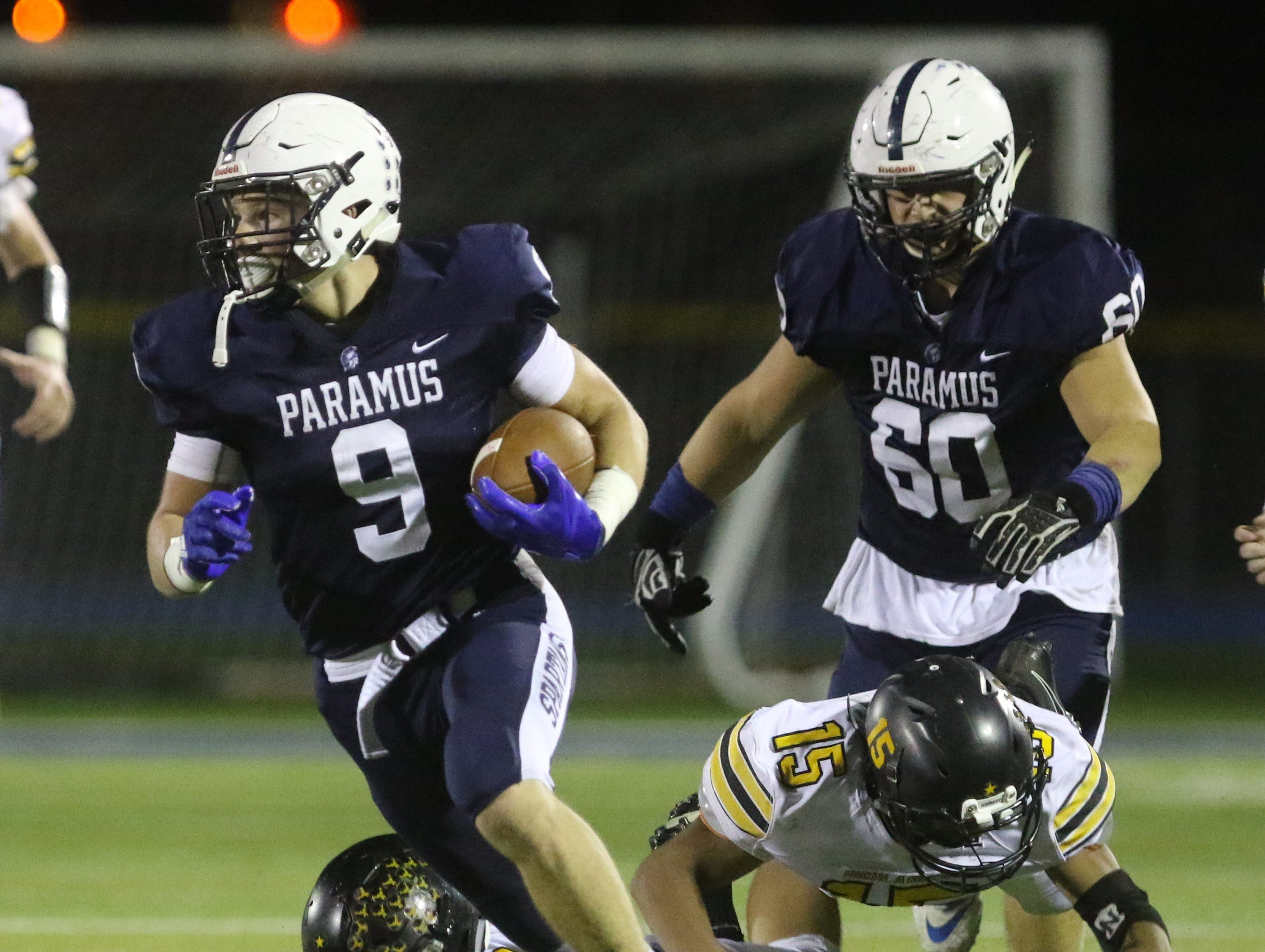 Kyle Jacob of Paramus beaks tackles on this first half run.