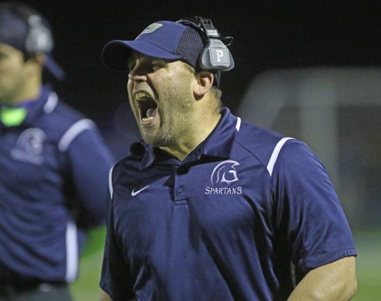 Paramus head coach Joe Sabella yells out instructions to his team in the first half.