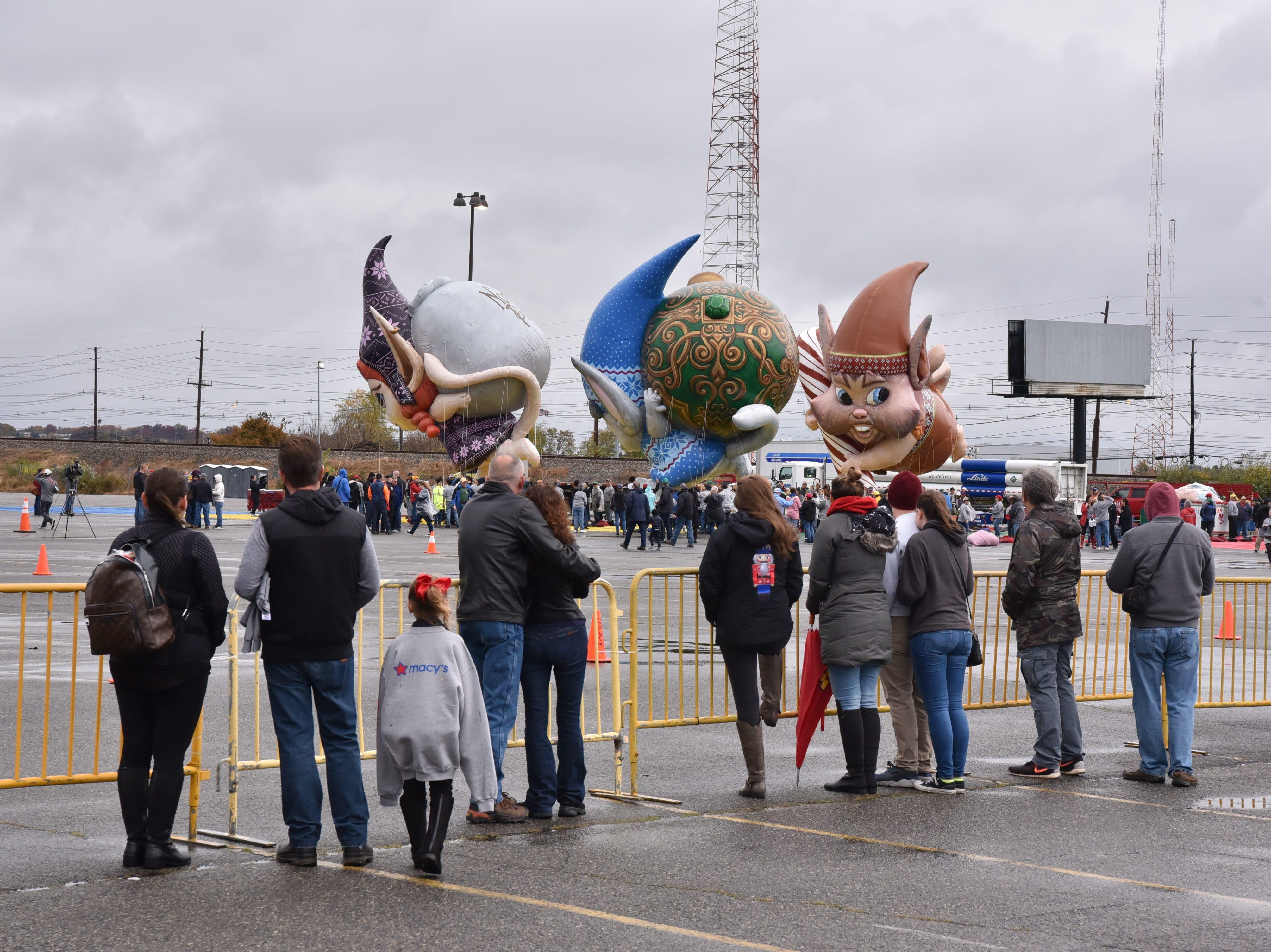 Visitors observe the newest Macy's Thanksgiving Parade balloons, Fleck, Bjorn and Jojo, at Metlife Stadium parking lot on Saturday, November 3.