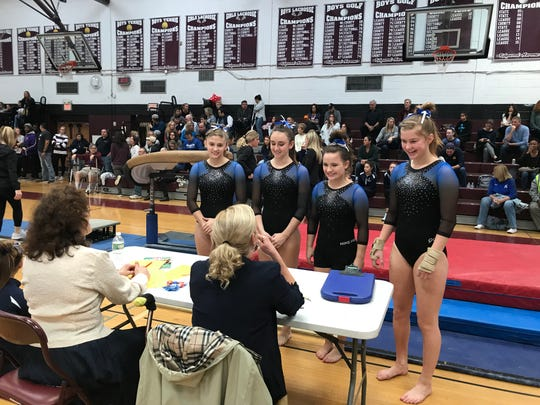 Pascack Regional gymnasts present to judges prior to the North 1 sectional vault competition on Saturday, Nov. 3, 2018. From left: Amanda Solda, Maya Horowitz, Marissa McGrane and Rachael Shakarjian 8.3