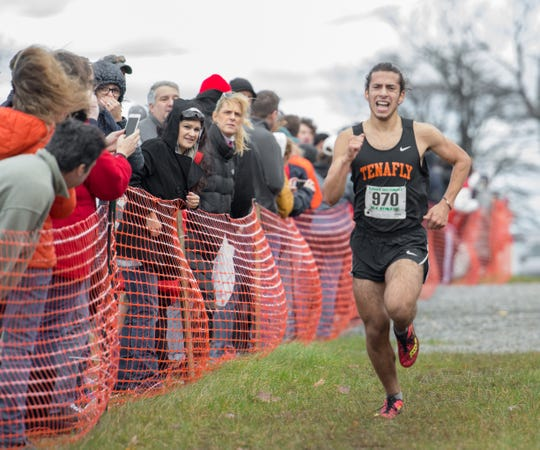 Fans watch as Carmel Ohring of Tenafly pushes himself to the finish line to place first in the Group 3 Boys 5K Run at the state sectional meet on Nov. 3
