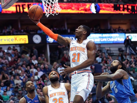 Nov 2, 2018; Dallas, TX, USA; New York Knicks forward Damyean Dotson (21) shoots during the second half against the Dallas Mavericks at American Airlines Center.