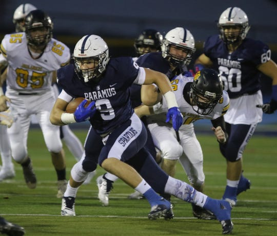 Kyle Jacob of Paramus runs the ball for a long gain to setup his team's first TD in the first half.