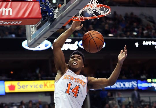 Nov 2, 2018; Dallas, TX, USA; New York Knicks guard Allonzo Trier (14) dunks during the second half against the Dallas Mavericks at American Airlines Center.