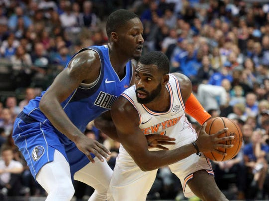 Dallas Mavericks forward Dorian Finney-Smith (10) defends as New York Knicks guard Tim Hardaway Jr. (3) looks for an opening in the first half of an NBA basketball game Friday, Nov. 2, 2018, in Dallas.
