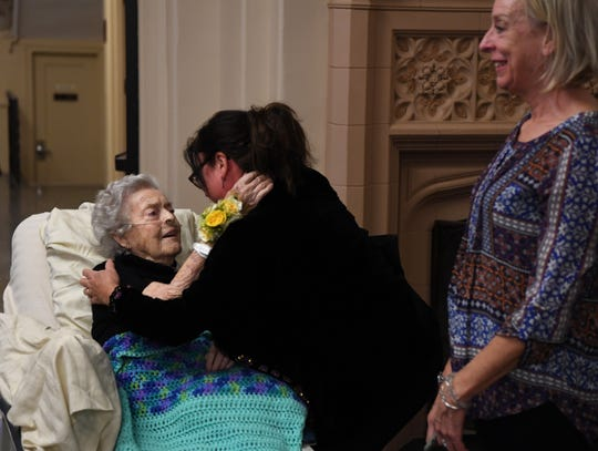 Marianne Fischer, 88, a patient at Villa Marie Claire in Saddle River, hugs Melissa Quarles, a family friend, during an art show of her work at Villa Marie Claire on Saturday, November 3, 2018.