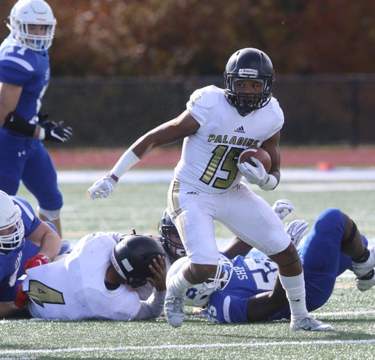 Richard Turner of Paramus Catholic heads up upfield after catching a first half pass.