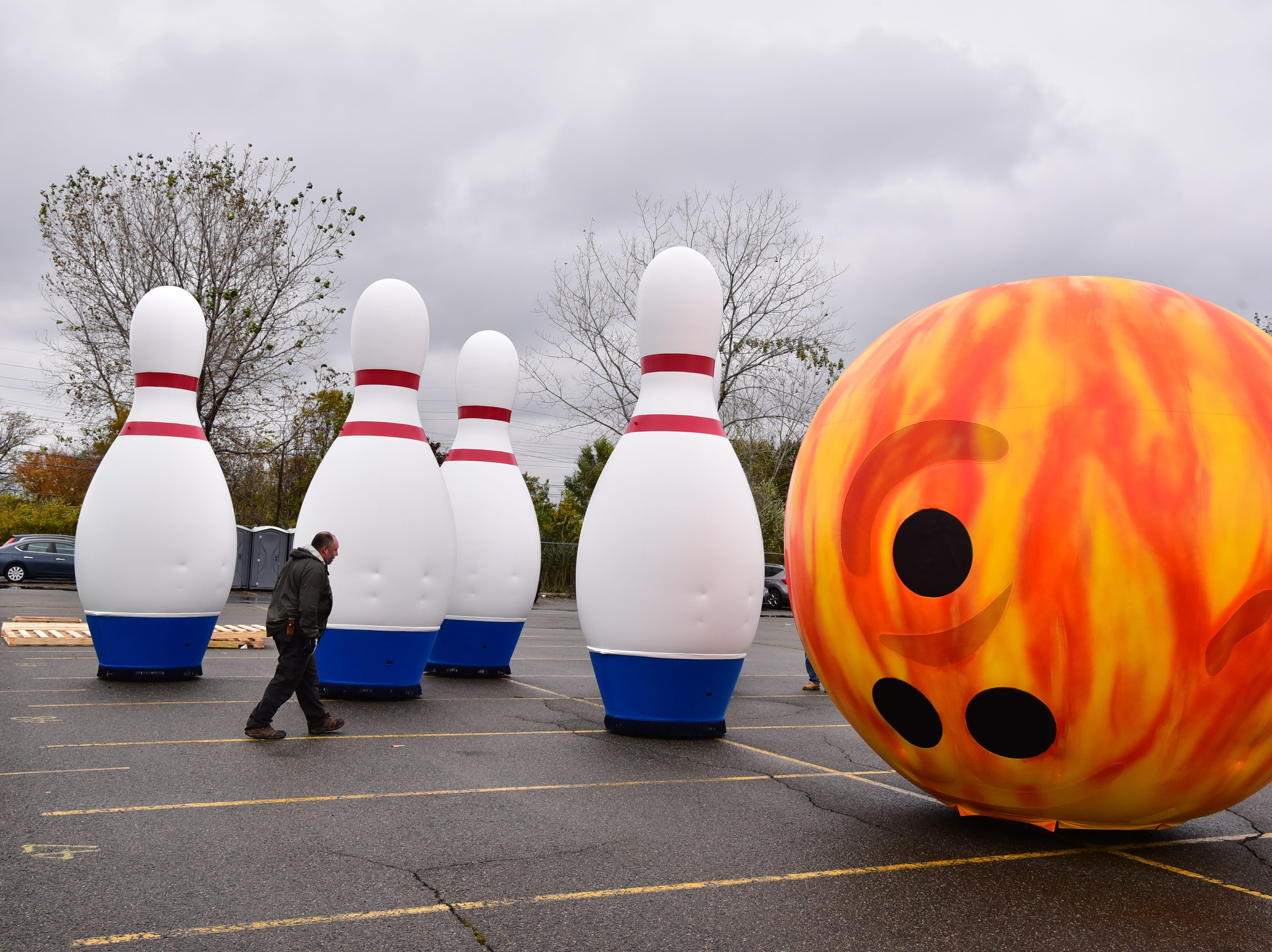 """The new """"Go Bowling"""" ballonicles are tested at MetLife Stadium parking lot on Saturday, November 3. Two bowling shoes and six bowling pins will be chased by a bowling ball down the route."""