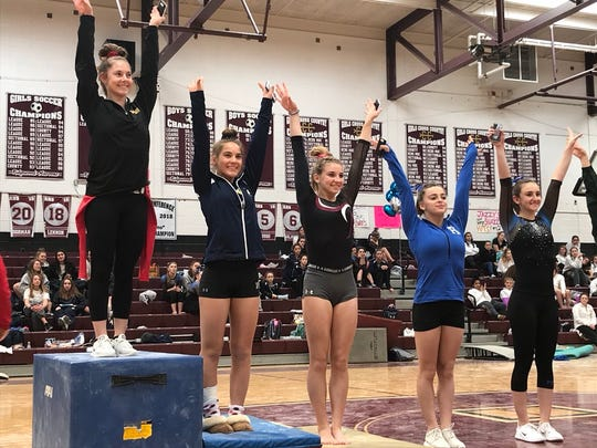 Mount Olive junior Brittany Wilder stands atop the podium after winning all-around gold at Saturday's North 1 sectional gymnastics meet. The top five (from left): Wilder, Indian Hills' Dani White, Ridgewood's Luz van Schijndel, Holy Angels' Faith Furletti and Pascack Regional's Maya Horowitz.