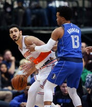 Nov 2, 2018; Dallas, TX, USA; New York Knicks center Enes Kanter (00) looks to pass as Dallas Mavericks guard Jalen Brunson (13) defends during the first half at American Airlines Center.