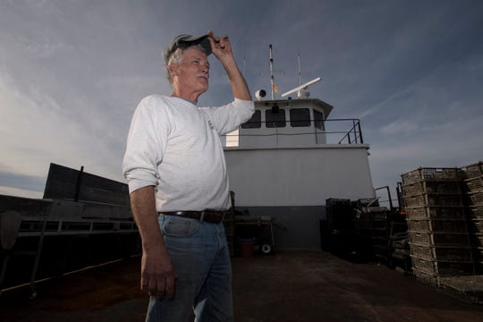 Steve Fleetwood Sr., who has operated the Bivalve Packing Company for over twenty five years, on a boat used for oyster farming on Thursday, November 1, 2018.
