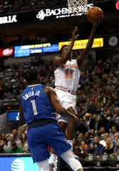 DALLAS, TEXAS - NOVEMBER 02:  Frank Ntilikina #11 of the New York Knicks takes a shot against Dennis Smith Jr. #1 of the Dallas Mavericks at American Airlines Center on November 02, 2018 in Dallas, Texas.