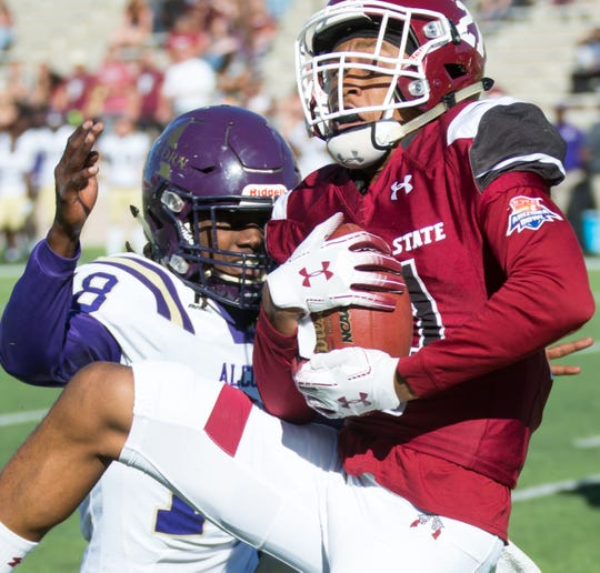 New Mexico State University wide receiver Anthony Muse holds onto the ball for a reception against Alcorn State on Saturday at Aggie Memorial Stadium.