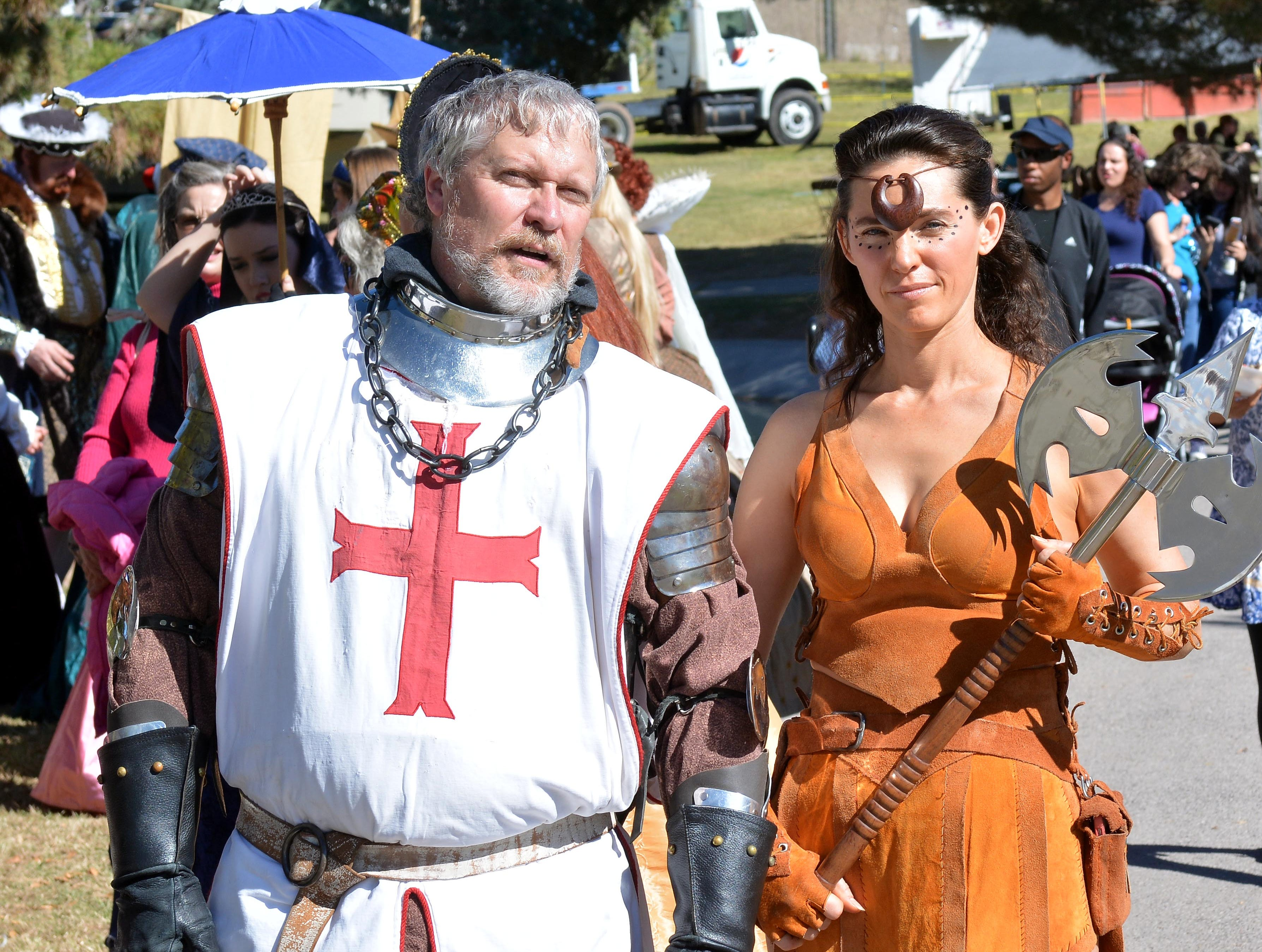 A knight and a female warriot stroll through Young Park on Saturday during the Renaissance Faire. Photo taken 11/3/18.
