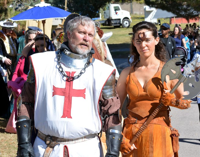A knight and a female warrior stroll through Young Park on Saturday during the Renaissance Faire. Photo taken 11/3/18.