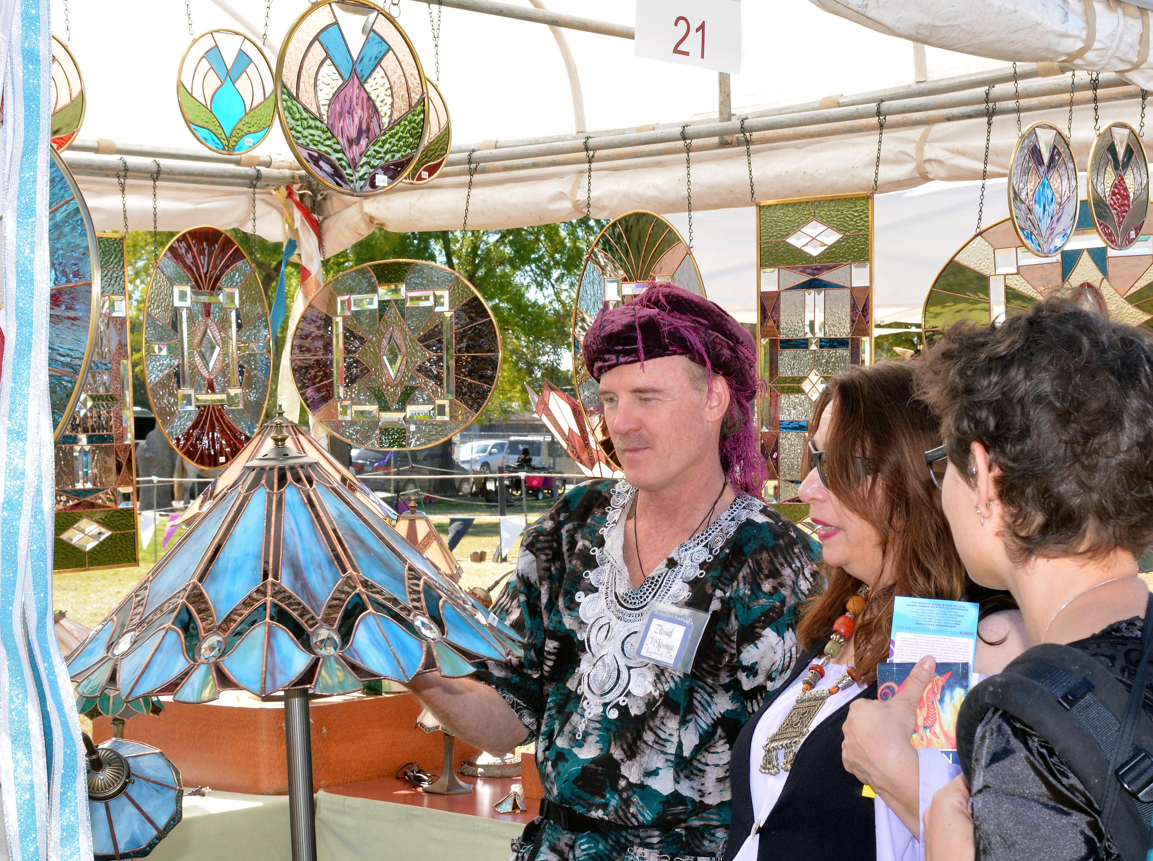 """Jamie Coryell and her daughter stop by """"Glass Originals,"""" one of the many vendors at the Renaissance Faire this year.  Photo taken 11/3/18."""