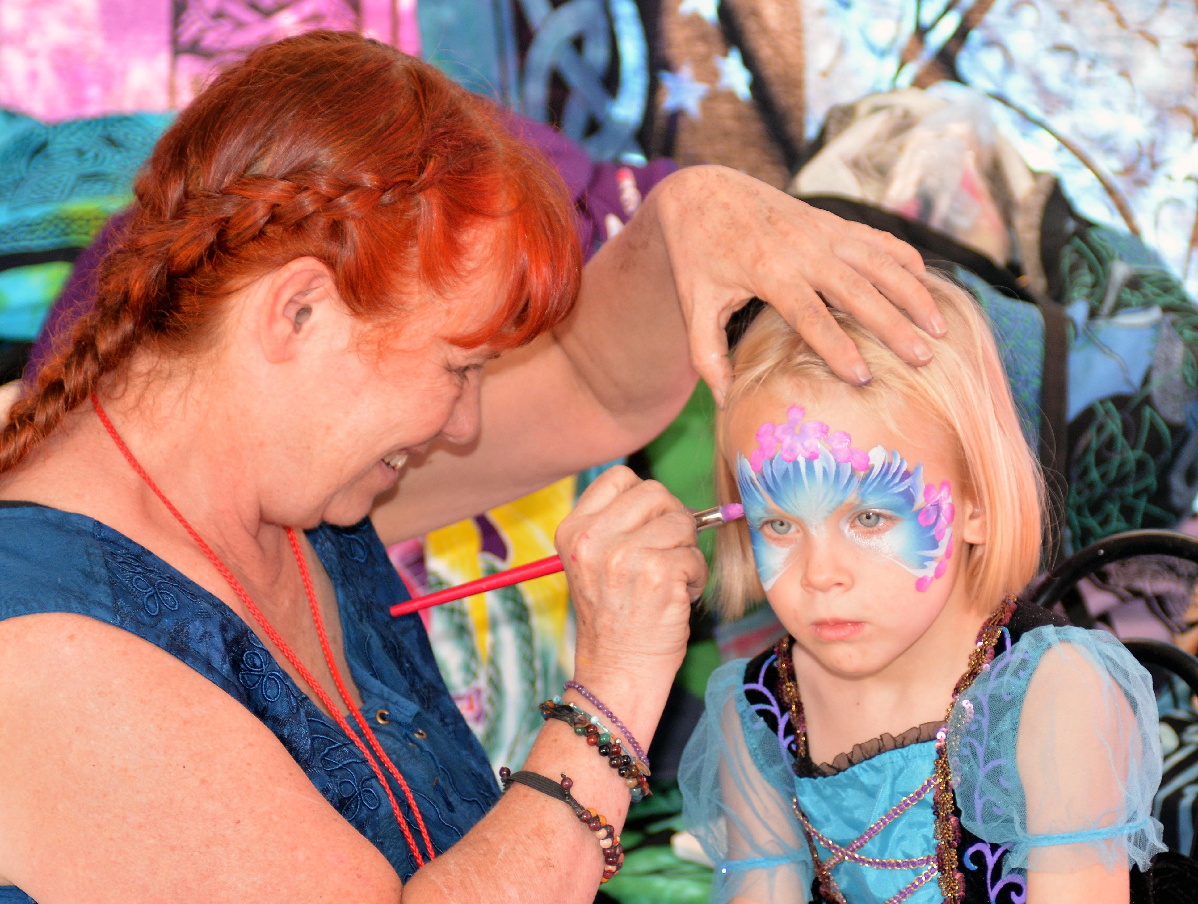 Four-year-old Grace Hempstead from Albuquerque gets her face painted.  Photo taken 11/3/18.