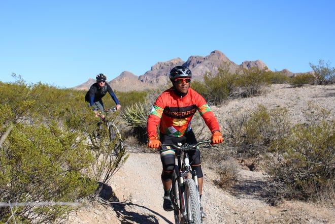 Mountain bikers enjoy a ride on a trail near the Dona Ana Mountains.