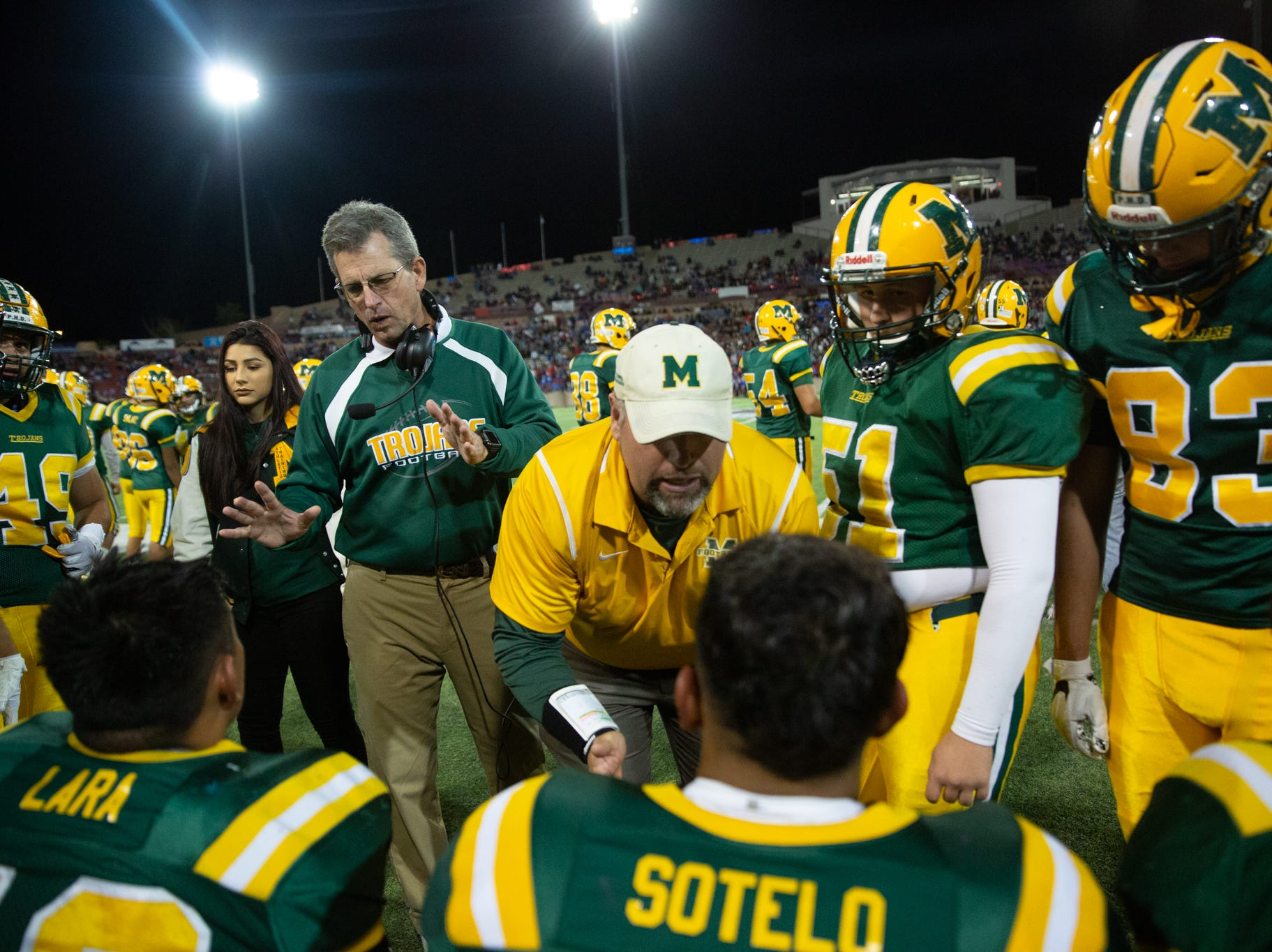 Mayfileld High School Head Coach Michael Bradley works with his coaching staff and players on the sideline during the Cruces/Mayfield football game on Friday, Nov. 2, 2018, at Aggie Memorial Stadium.