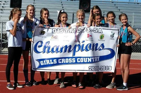 The Oñate girls cross country team won the District 3-5A championship Saturday at Centennial High School.